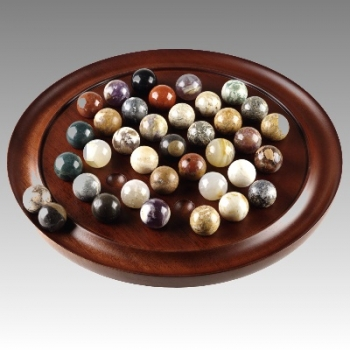 Solitaire Game, with 38 balls (2 of them spare) from polished semi precious stones, Ø 20 mm, antique design, mahogany tray, Dimensions: h 4 x Ø 25 cm