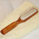 Hair Brush Olive Wood, longish, with wood pins, Dimensions: l 20 x w 3.5 cm