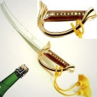 Laguiole Champagne Sabre Kellerman in oak wood presentation cassette, hilt 22 kt gilded, wood inlay handle, yellow dragoon tassels, blade 30 cm
